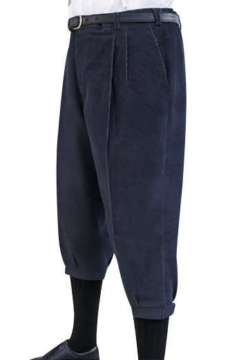 Sewn down reverse double pleat golf pants. Made to measure with easy access slash pockets, a zipper fly, and elastic cuffs with epaulets and velcro.