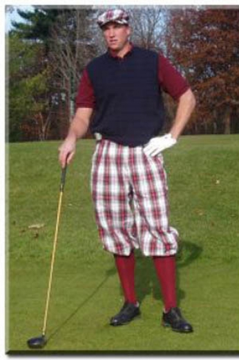 Mens traditional plaid flat front golf pants tailor-made with a baggy fit for mobility and slash pockets, a zipper fly, and elastic cuffs.