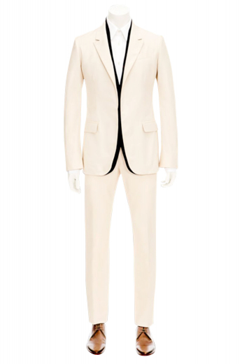 A made to measure slim cut suit composed of a handmade single breasted two button suit jacket with pressed shallow notch lapels, paired with classic flat front suit pants.