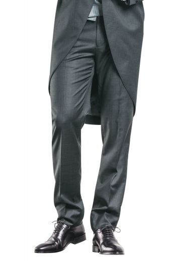A handmade pair of elegantly sophisticated dark grey flat front suit pants made for a comfortable fit, these pants feature classic details such as slash pockets, a zipper fly, and hand-sewn cuff hems.