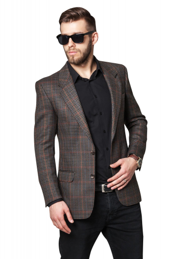 This stunning mens custom made brown plaid jacket in cashmere wool is an iconic formal from the luxurious range of affordable formals at My Custom Tailor. This mens made to order plaid jacket has 2 notch lapels with 1 boutonniere on the left lapel. This mens custom made slim fit brown jacket also features 2 front close buttons, 1 upper welt pocket, and 2 lower pockets with flaps. Wear this mens bespoke cashmere wool plaid jacket to interviews and board meetings for a lasting impression.