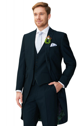 Mens must buy tailor made dark navy blue cashmere tailed tuxedo. Features a bespoke slim fit jacket, a custom made vest, and dress pants. The mens handmade tailed jacket features 2 notch lapels, 1 boutonniere on the left lapel, 1 upper welt pocket, 2 lower flapped pockets, and a flapped ticket pocket on the left. The mens custom made vest has 5 front buttons, 2 piped lower pockets, and an adjustable cloth back with a buckle. The mens bespoke tux pants have a 2 point button and hook closure, a zip fly, and 2 front slash pockets.