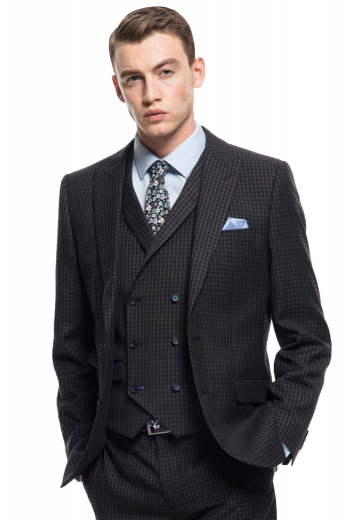 Mens handmade black 3pc wool suit with stunning checks. Features a tailor made double breasted vest with 6 front buttons, 3 to close, a custom made jacket with peak lapels and a center vent, and bespoke slim fit dress pants with hand sewn cuff hems. The mens bespoke slim fit vest has a shawl collar and a cloth back with an adjustable buckle. The mens custom made dinner jacket has 2 boutonnieres on the left lapel. And, the mens bespoke grey dinner pants have a zip fly. Buy this mens bespoke 3 piece plaid suit at My Custom Tailor.