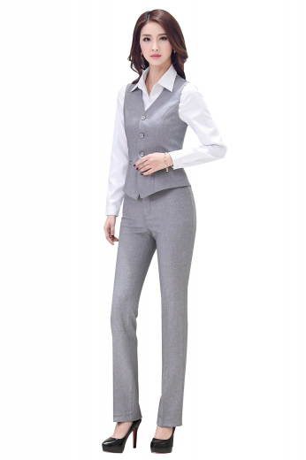 Flattering womens handmade grey pant suit in cashmere. Perfect autumn garment from the office-wear collection at My Custom Tailor. It has a womens handmade slim fit vest and womens bespoke flat front pants. The womens made to order single breasted vest has a V neck, 2 lower welted pockets, and a cloth back with an adjustable buckle for classy fitting. The womens bespoke full length suit pants with a slim cut fitting is hand sewn with belt pockets and a 2-point button and hook closure. Wear it to flaunt a stylish look at work.