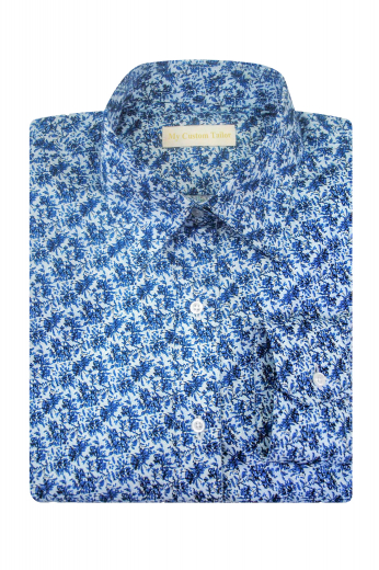 This jaw dropping womens handmade floral blouse in blue is a visual delight. You can wear it at all formal events and interviews. This womens custom made slim fit blouse features a beautifully hand stitched Ainsley collar with 2 attractive 1/2 inch collar points. This stunningly stylish womens bespoke cotton dress shirt with a placket front and plain back also has 2 hand sewn rounded barrel cuffs for extra oomph. Buy it at My Custom Tailor to be a trendsetter at work.