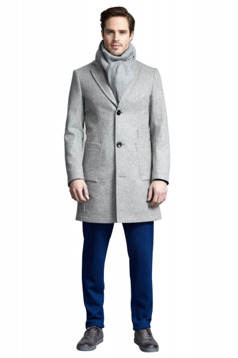 This men's custom made grey coat is tailor made in a fine wool blend and cut to a slim fit, featuring slash pockets, extended belt loops and a flat front pleat. It is a classic winter coat, sure to become a staple in your everyday wardrobe!