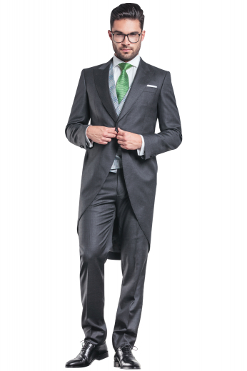 A hand tailored men's flattering formal jacket tailor made in a wool blend, featuring a single breasted button closure, peak lapels, and handstitched pockets paired with matching suit pants.