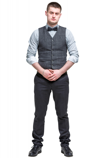A custom bespoke men's hand tailored dark grey vest. This stunning men's vest is tailor made in a wool blend featuring a single breasted closure and v neck, with piped lower pockets.