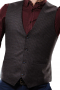 This men's slim cut vest is custom made in a wool blend featuring a single breasted closure and v neck. It is perfect for all occasions.