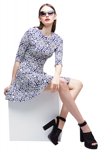 This women's dress is custom made in an ultra slim fit. It lands just above the knee and features a round neck and three-fourth sleeves.