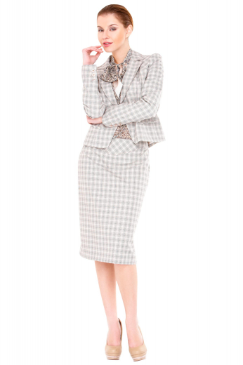 This elegant knee length skirt suit features a center back slit and a sleek single breasted closure.