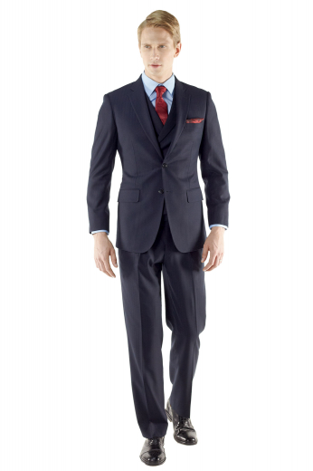 This custom made suit features a slim cut, versatile two button fit, flap pockets, notch lapel, and a lightly padded shoulder for a sharp, well-defined appeal with single small reverse pleat and urban styled three button double breasted waistcoat.