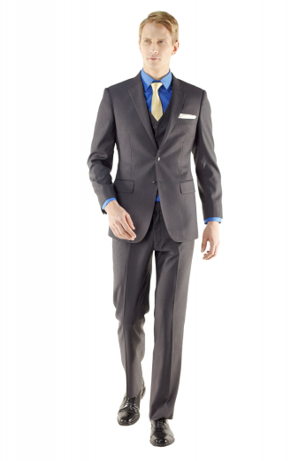 This three piece custom suit designed with sous bras, patch pockets and flat front trousers is made for those on the go. The suit is accompanied with a five button waistcoat which makes it suitable for any formal occasion.