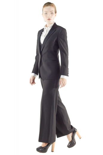 Exquisitely hot made to order black pant suits with figure defining V neck custom vests incorporating two welted lower pockets, four front closure buttons and angled V cut bottoms. Handmade sexy suit jackets with short length and two front buttons, also display satin facing notch lapels, four buttons on sleeves cuffs and double piped lower pockets. Custom tailored flare legs suit pants with flat fronts have extended buttoned waistband and zipper fly to close.