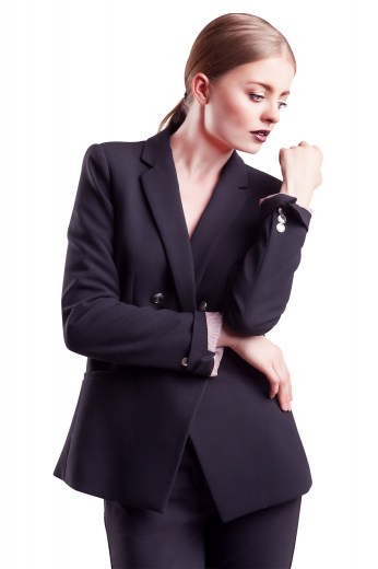 This gorgeous womens custom made navy blue wool blazer is a stunner that you can wear to the office daily. With stunning features like 3 inch wide notch lapels and 2 lower welt pockets, this womens handmade double breasted jacket also features 4 contrast buttons with 2 to close. This womens custom made slim fit navy blue blazer also features hand moulded shoulders. You can buy this super comfortable womens bespoke navy blue jacket in wool at My Custom Tailor to flaunt a stellar corporate look.