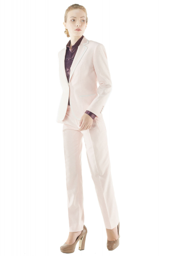 This beautifully hand stitched womens bespoke salmon tuxedo in cashmere wool features a handmade slim fit tuxedo jacket and tailor made tuxedo pants. The womens made to order dress pants have a single standard reverse pleat pattern, 2 front slash pockets, elegantly hand sewn cuffs hems, a zipper fly, and a 2 point button and hook closure. The womens bespoke slim fit jacket has 1 fabric covered front close button, 2 piped notch lapels, 2 double piped lower pockets, and a princess dart front and back.