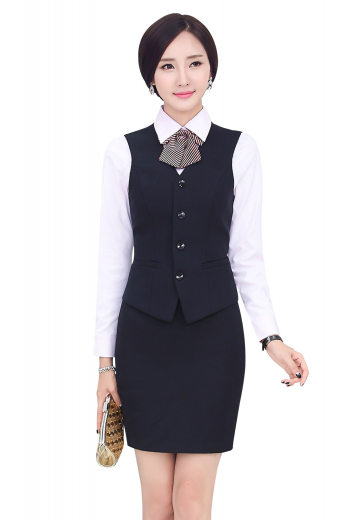 Womens handmade dark Navy skirt suit in twill cotton. An ideal office wear with an elegantly stitched custom pencil skirt and a handmade single breasted vest. The womens custom made pencil skirt with a back center vent and a back zipper for closure provides all day comfort with a flat front that sits right above the knees. The womens handmade slim fit vest features a V-neck, 4 front closure buttons, and 2 lower welted pockets. The womens made to order cotton vest also features a back with an adjustable buckle for perfect fitting.