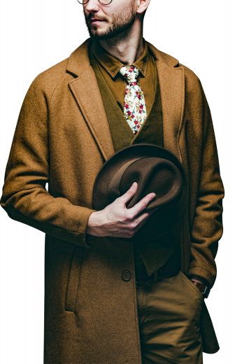 This men's custom made caramel colored coat is tailor made in a fine wool and tweed and cut to a slim fit, featuring a single breasted button closure, slanted welt pockets, and edge stitched pockets and lapels. It is a classic winter coat, sure to become a staple in your everyday wardrobe!