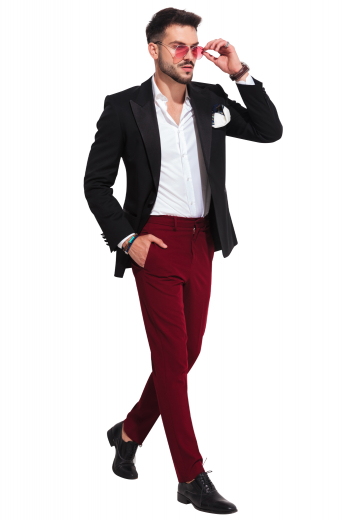 This men's bold red pant is tailor made in a fine wool blend and cut to a slim fit, featuring slash pockets, extended belt loops, and a flat front pleat. They are a stylish option for any office or special occasion.