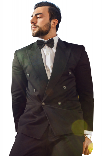 This sleek men's pant suit is tailor made in a fine wool blend and cut in a slim fit, featuring  double breasted button closures and slash pockets.