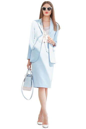 This skirt suit adds instant elegance to your outfit. It is custom made with a classic single breasted button closure and a modest slit. A splendid custom made women's skirt suit in wool blend, with classic single breasted closure in a classy light blue.