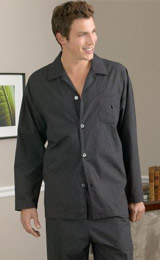 A tailor-made men's comfortably loose cut rounded bottom dark grey pajama button-down shirt with matching loose cut flat front pants with the elegant touch of on-seam pockets.