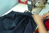 Side seams on our custom jackets are machine sewn and designed for extra strength