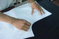 Paper Patterns are cut and overlaid on the fabric for all our custom pants